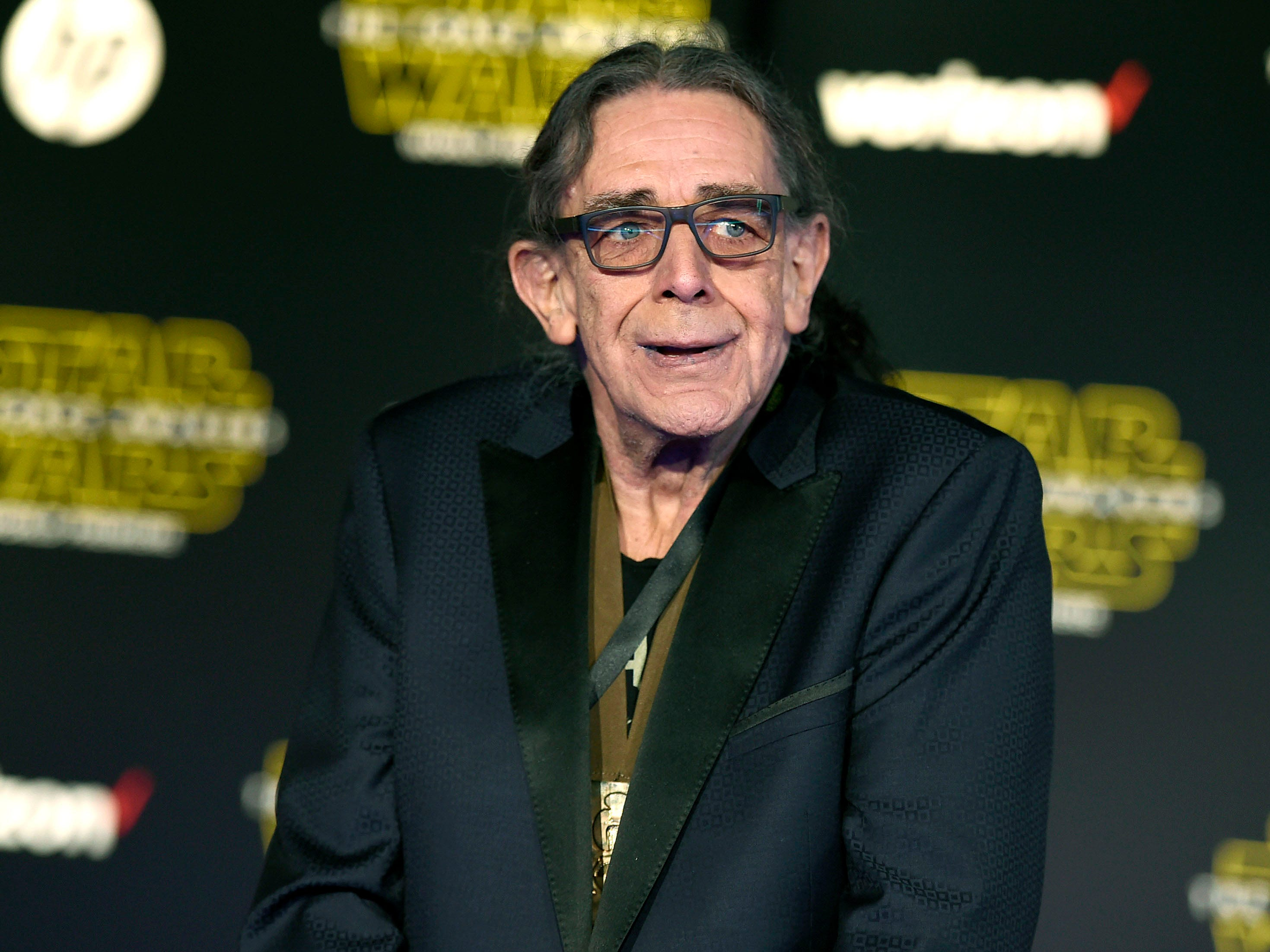 """In this Dec. 14, 2015, file photo, Peter Mayhew arrives at the world premiere of """"Star Wars: The Force Awakens"""" in Los Angeles. Mayhew, who played the rugged, beloved and furry Wookiee Chewbacca in the """"Star Wars"""" films, has died. Mayhew died at his home in north Texas on Tuesday, April 30, 2019 according to a family statement. He was 74. No cause was given."""