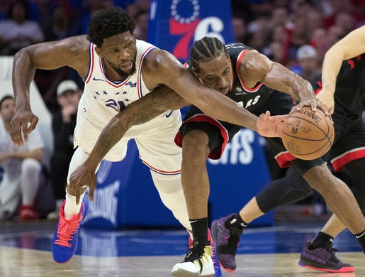 May 2: Raptors forward Kawhi Leonard (2) scramble for a loose ball against 76ers center Joel Embiid (21) during Game 3.