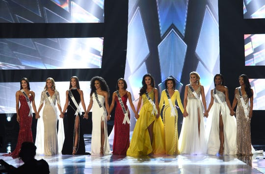 The top 10 competitors for the title of Miss USA line up on stage in Reno, Nev., on Thursday night. Miss Arkansas USA Savannah Skidmore is the first contestant from the left.