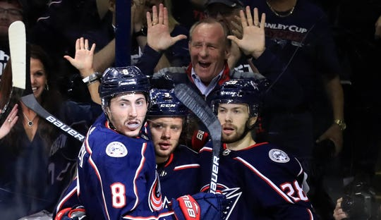 Blue Jackets left wing Artemi Panarin (middle) celebrates after scoring against the Bruins.