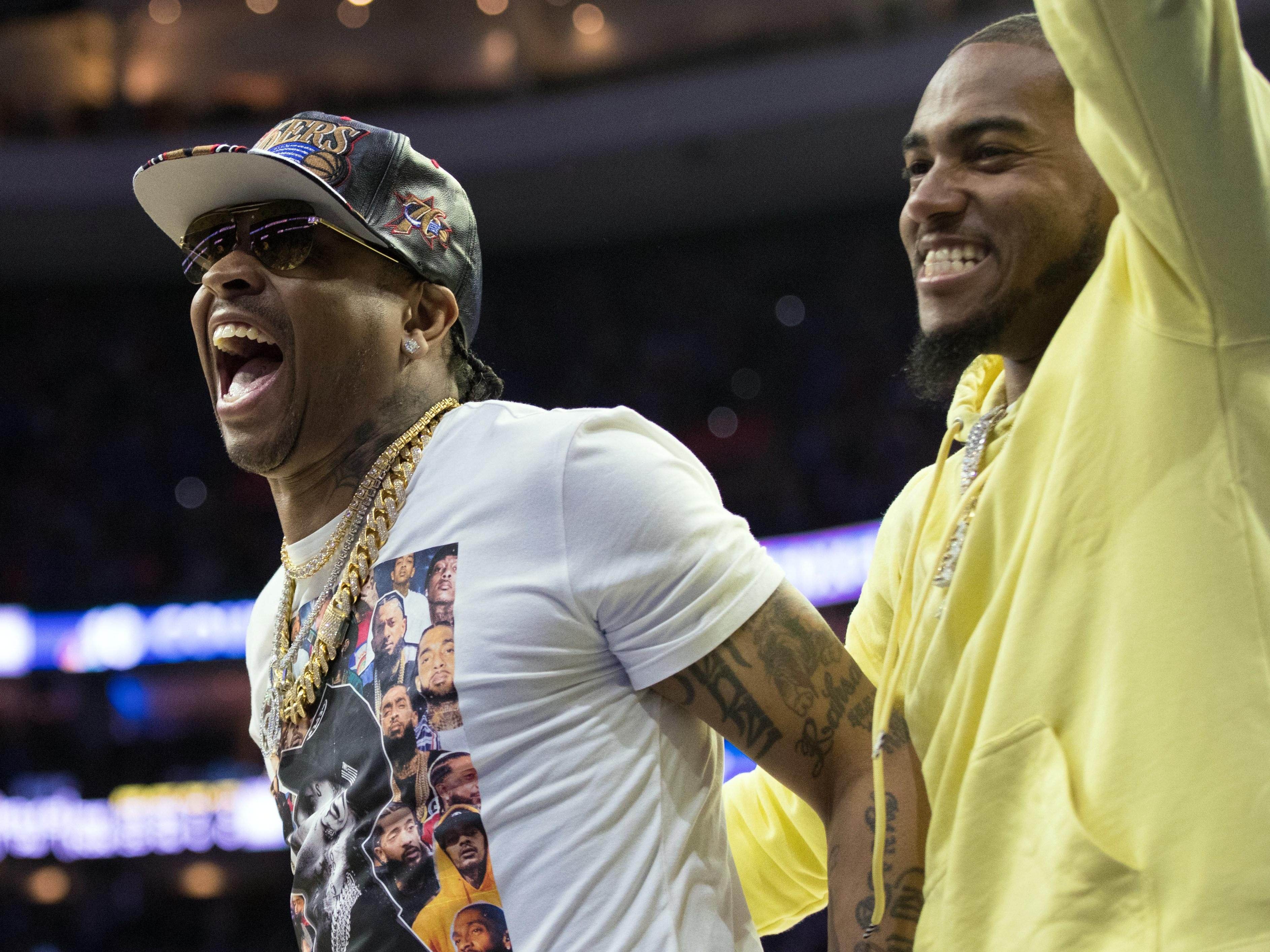 May 2: Allen Iverson, left, and DeSean Jackson were fired up for the 76ers' big win over the Raptors in Game 3.