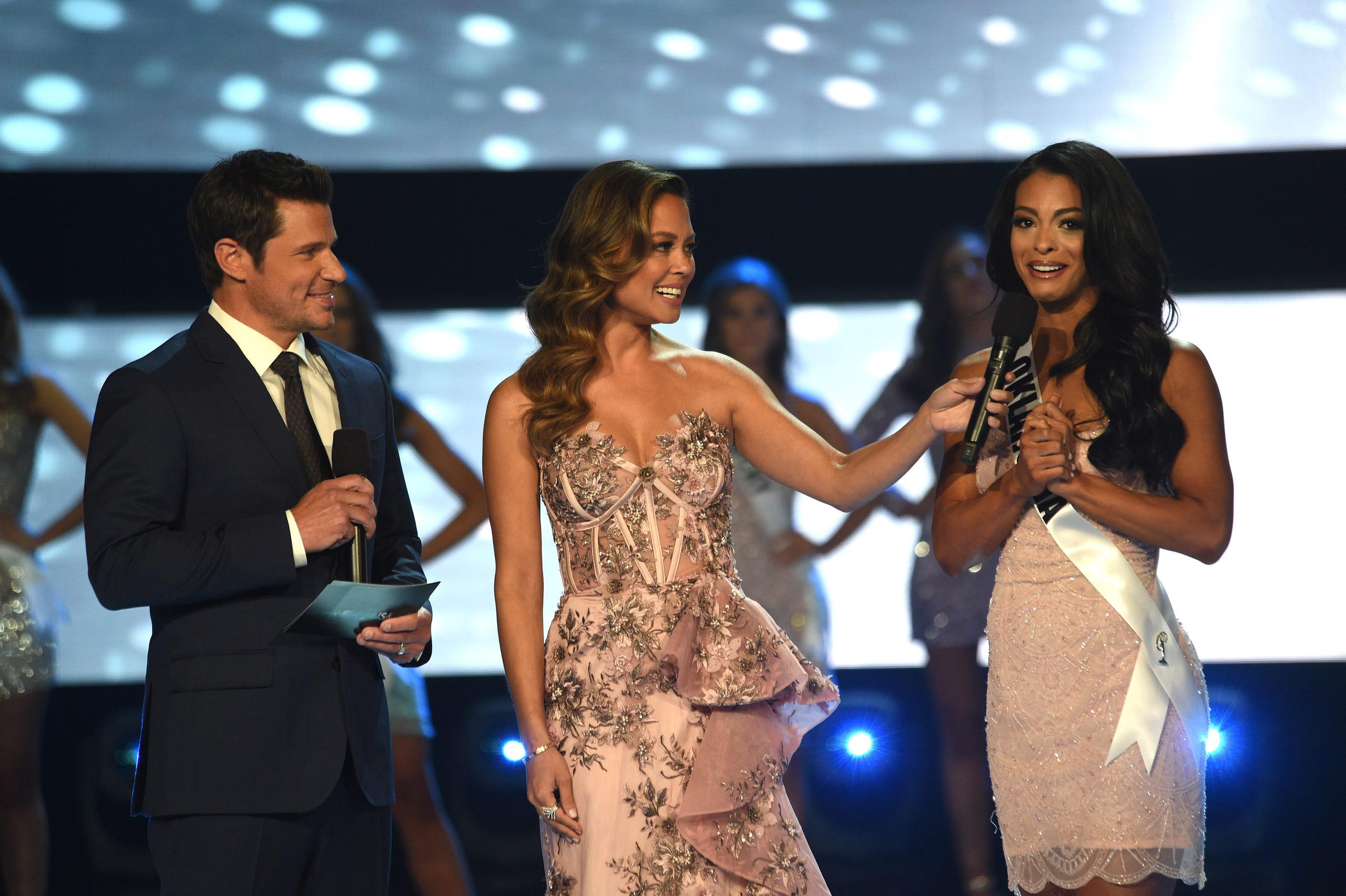 Co-hosts Vanessa and Nick Lachey talk with Triana Browne, Miss Oklahoma, during Miss USA 2019.
