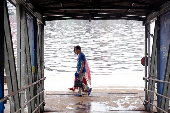 A Bangladeshi family walks at the empty launch terminal during a rainy day in Dhaka, Bangladesh 03 May 2019. According to media reports, the Bangladesh Inland Water Transport Authority (BIWTA) suspended inland water transport in anticipation of Cyclone Fani, after the cyclone made landfall in Odisha state in India and approaches the southwest coast of Bangladesh.