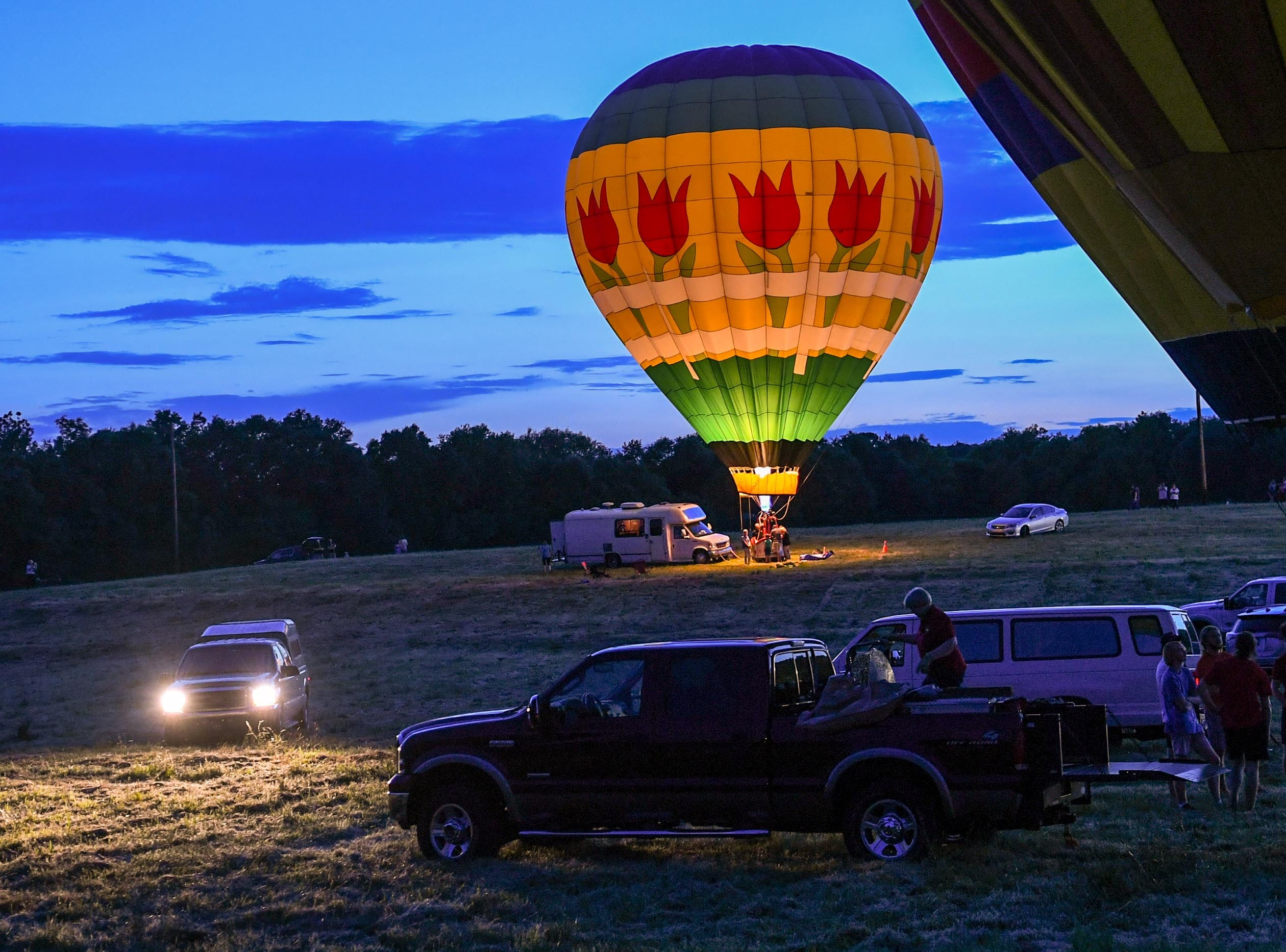 Balloons glow at the Rocky River Plantation during the Cancer Association of Anderson Hot Air Balloon Affair in Anderson Friday.