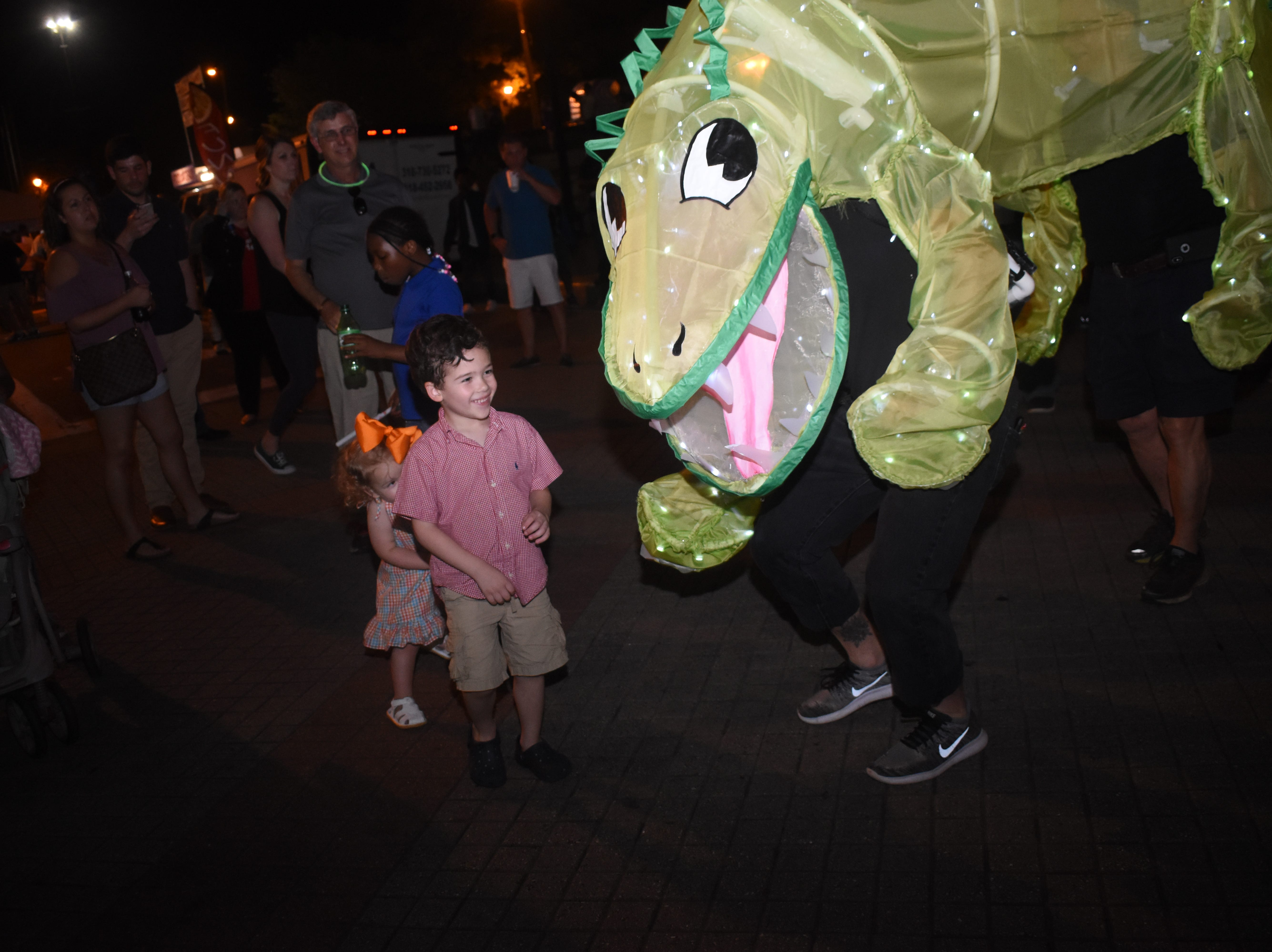 The Alexandria Red River Festival kicked off Friday, May 3, 2019 in downtown Alexandria with vendors, street performers and live music. The Alexandria Museum of Art held their Spring Illuminate the Arts Procession through downtown included various characters, animals and objects illuminated by lights. The Red River Festival continues Saturday along with with a bbq cookoff, classic car and truck show. The Louisiana Dragon Boat Races will be held at Lake Buhlow in Pineville starting at 9 a.m.