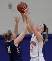 Appleton West's Taylor Lauterbach (41) gains control of the ball after blocking a shot against Appleton North during their girls basketball game in January.