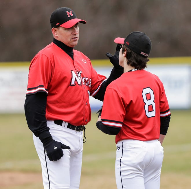 Neenah head coach Jack Taschner talks to Jaden Hackbarth during their game against Fond du Lac on April 18 in Fond du Lac.