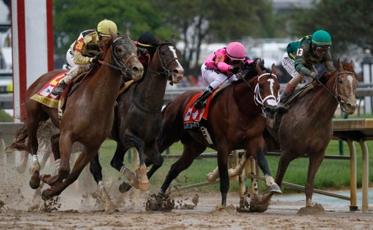 Flavien Prat on Country House, left, races against Luis Saez on Maximum Security, second from right, during the 145th running of the Kentucky Derby horse race at Churchill Downs Saturday, May 4, 2019, in Louisville, Ky. Maximum Security was disqualified and Country House won the race.