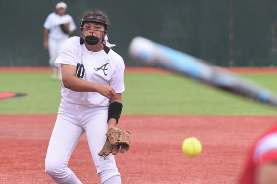 Abilene High's Kaylen Washington (10) pitches during Game 1 of the Region I-6A area playoff at Lubbock-Cooper on Friday, May 3, 2019. Washington worked all 10 innings for the win while adding two hits and an RBI as the Lady Eagles won 5-4 in 10 innings.