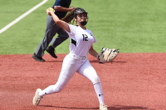 Abilene High third baseman Aubrianna Salazar (12) throws to first for an out during Game 1 of the Region I-6A area playoff at Lubbock-Cooper on Friday, May 3, 2019. The Lady Eagles won 5-4 in 10 innings.