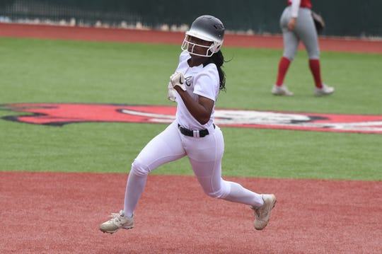 Abilene High's KK Roberson (22) rounds second and would score during the fourth inning of Game 1 of the Region I-6A area playoff at Lubbock-Cooper on Friday, May 3, 2019. Roberson had three hits and scored three runs as the Lady Eagles won 5-4 in 10 innings.