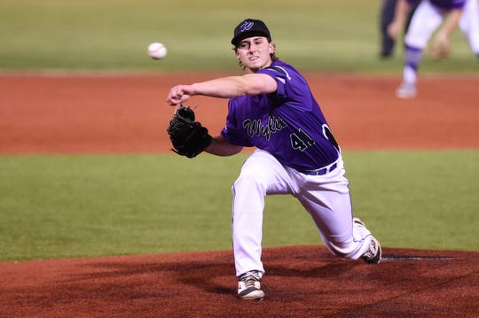 Wylie's Tyler Spears (41) earned the win in Game 1 of the Region I-5A bi-district series against Lubbock-Cooper with two innings of relief on Friday, May 3, 2019. The Bulldogs won 8-7.