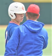 Cooper coach Cody Salyers talks to Jacob Hummel after Hummel's leadoff triple in the fifth inning against Lubbock Coronado. Coronado beat the Cougars 7-0 to sweep the Region I-5A bi-district playoff series Saturday, May 4, 2019, at McCanlies Field in Odessa.