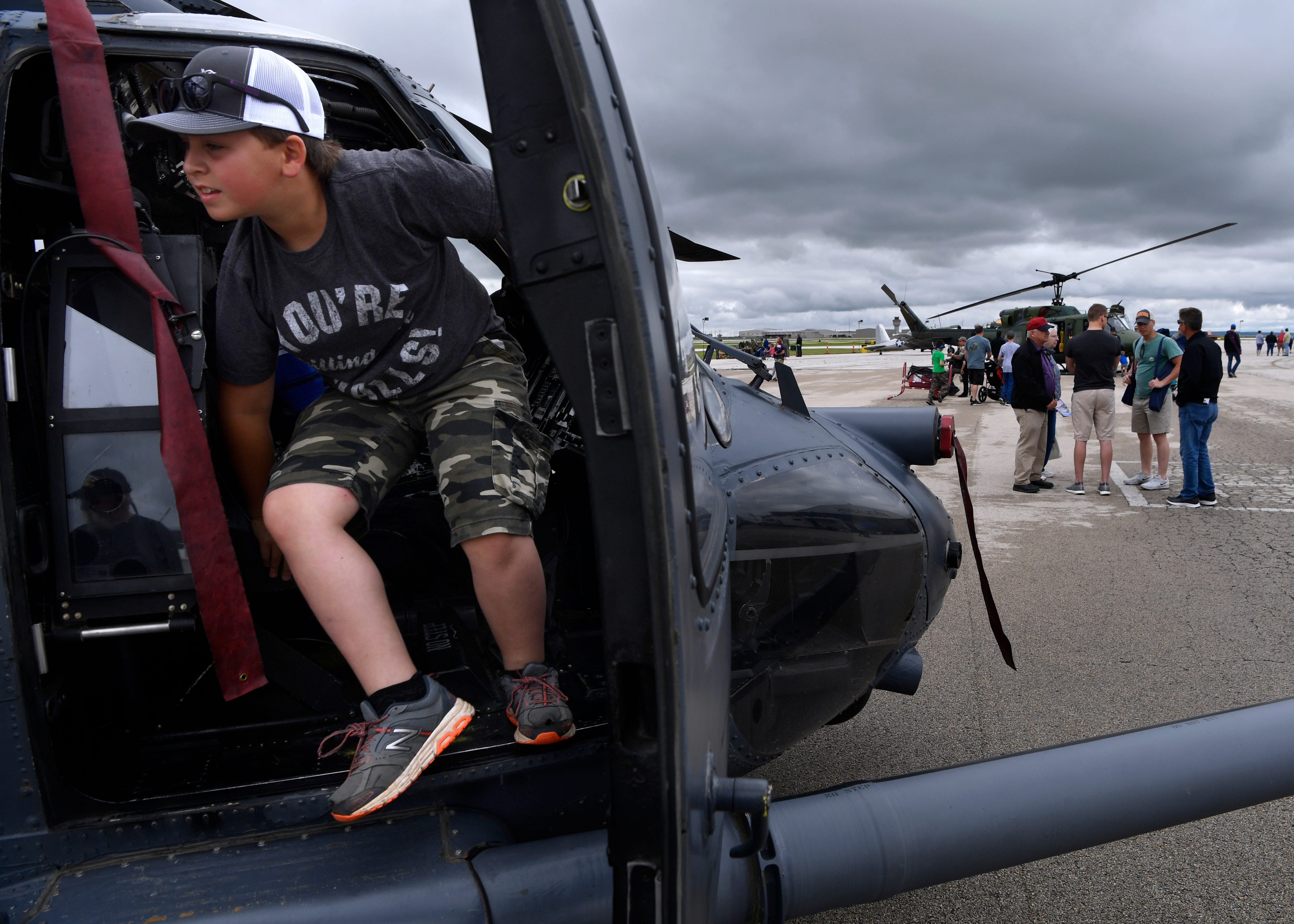 Cooper Morris, 10, of Merkel, climbs out of Blackhawk helicopter during the Dyess Big Country Airfest on Saturday at Abilene Regional Airport.