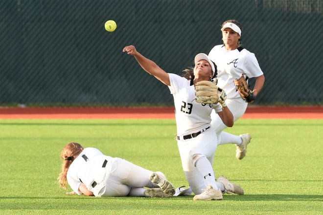Abilene High shortstop Alyssa Washington (23) throws home after catching a short fly ball for a double play in the top of the 10th inning. Washington then delivered a walk-off double in the bottom of the inning as the Lady Eagles beat Odessa High 5-4 in Game 1 of the Region I-6A area playoff series at Lubbock-Cooper on Friday, May 3, 2019.