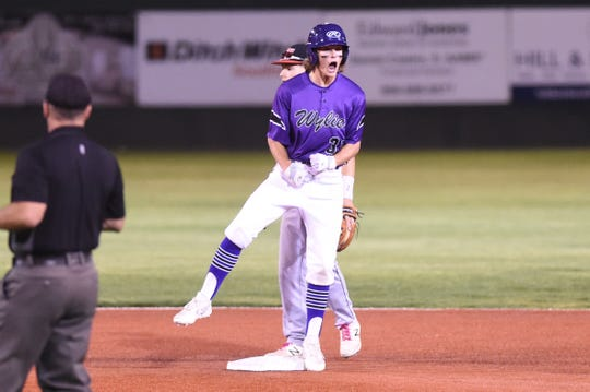 Wylie's Tyler Martin (31) reacts after hitting a two-run double in the sixth inning of Game 1 of the Region I-5A bi-district series against Lubbock-Cooper on Friday, May 3, 2019. Martin had three hits, two RBIs and scored in the Bulldogs 8-7 win.
