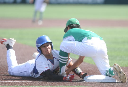 Hamlin third baseman Levi Barrientes tags out Gorman's Asael Maldonado on a steal attempt in the first inning of Game 2 of the teams' Region I-1A bi-district baseball series Friday, May 3, 2019, at Abilene Christian's Scott Field.