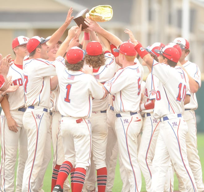 The Jim Ned baseball team lifts its bi-district trophy following its 11-1 win over Eastland in Game 3 on Saturday, May 4, 2019, at Abilene Christian's Scott Field.