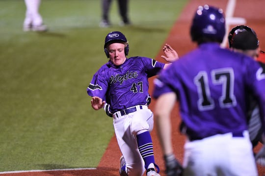 Wylie's Balin Valentine (47) slides safely home in the sixth inning of Game 1 of the Region I-5A bi-district series against Lubbock-Cooper on the road Friday, May 3, 2019. The Bulldogs won 8-7.