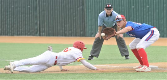 Lubbock Coronado's Caden Hensley, left,  dives back to first as Cooper first baseman Braiden Hill fields the pickoff throw from pitcher Matt Shira in the fourth inning. Coronado beat the Cougars 7-0 to sweep the Region I-5A bi-district playoff series Saturday, May 4, 2019, at McCanlies Field in Odessa.