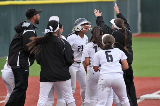 Abilene High's Alyssa Washington (23) and the Lady Eagles celebrate their 5-4, 10-inning win in Game 1 of the Region I-6A area playoff at Lubbock-Cooper on Friday, May 3, 2019.