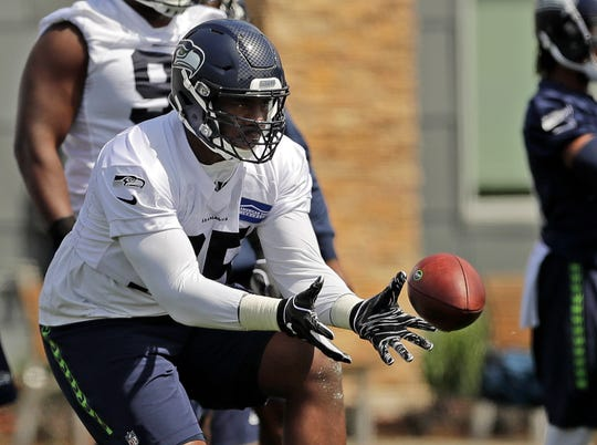 Seattle Seahawks defensive end L.J. Collier catches the ball during NFL football rookie mini camp Friday in Renton, Wash.