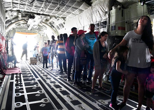 Visitor line up inside the cargo fuselage of a C-130J Hercules on Saturday. The Dyess Big Country Airfest was held this year at Abilene Regional Airport