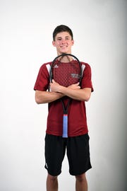 Zach Theodossiou is a senior on the Asheville High School tennis team.