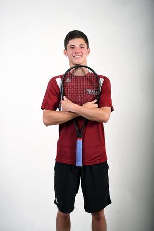 Zach Theodossiou is a senior on the Asheville High School tennis team.