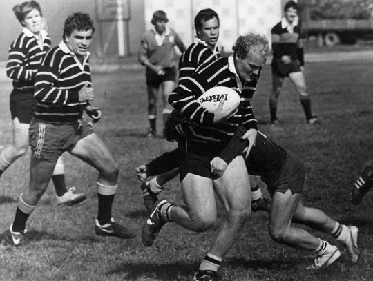 Al Houser (left) trails the ball carrier in an undated Battle Creek Griffons game.