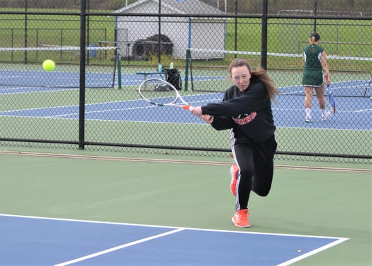 St. Philip's Alexis Behnke returns serve at No. 1 singles during early round play at the All-City Girls Tennis Tournament at Harper Creek on Saturday.