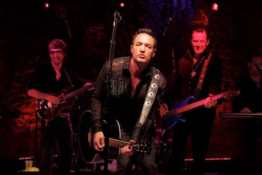 Randy Cordeiro on stage as Surreal Neil.