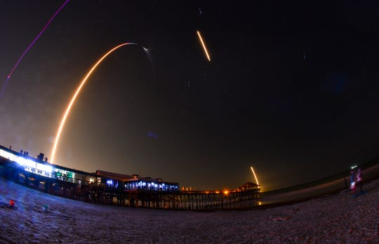 A SpaceX Falcon 9 rocket launches from Cape Canaveral on the company's 17th resupply run to the International Space Station on Saturday, May 4, 2019. The rocket's first stage landing burns can be seen off to the right.