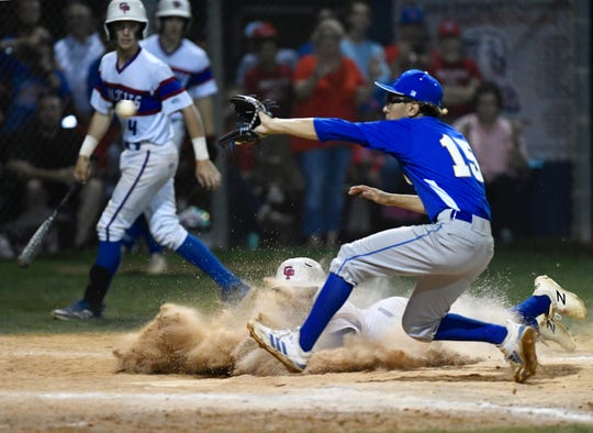 Gregory-Portland slides into home ahead of the tag from Moody's Christian Rodriguez in the sixth inning of a Class 5A bi-district playoff game at Portland's Wildcat Field on Friday, May 3, 2019