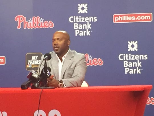 Jimmy Rollins talks to the press as he officially retires as a Phillie on Saturday.