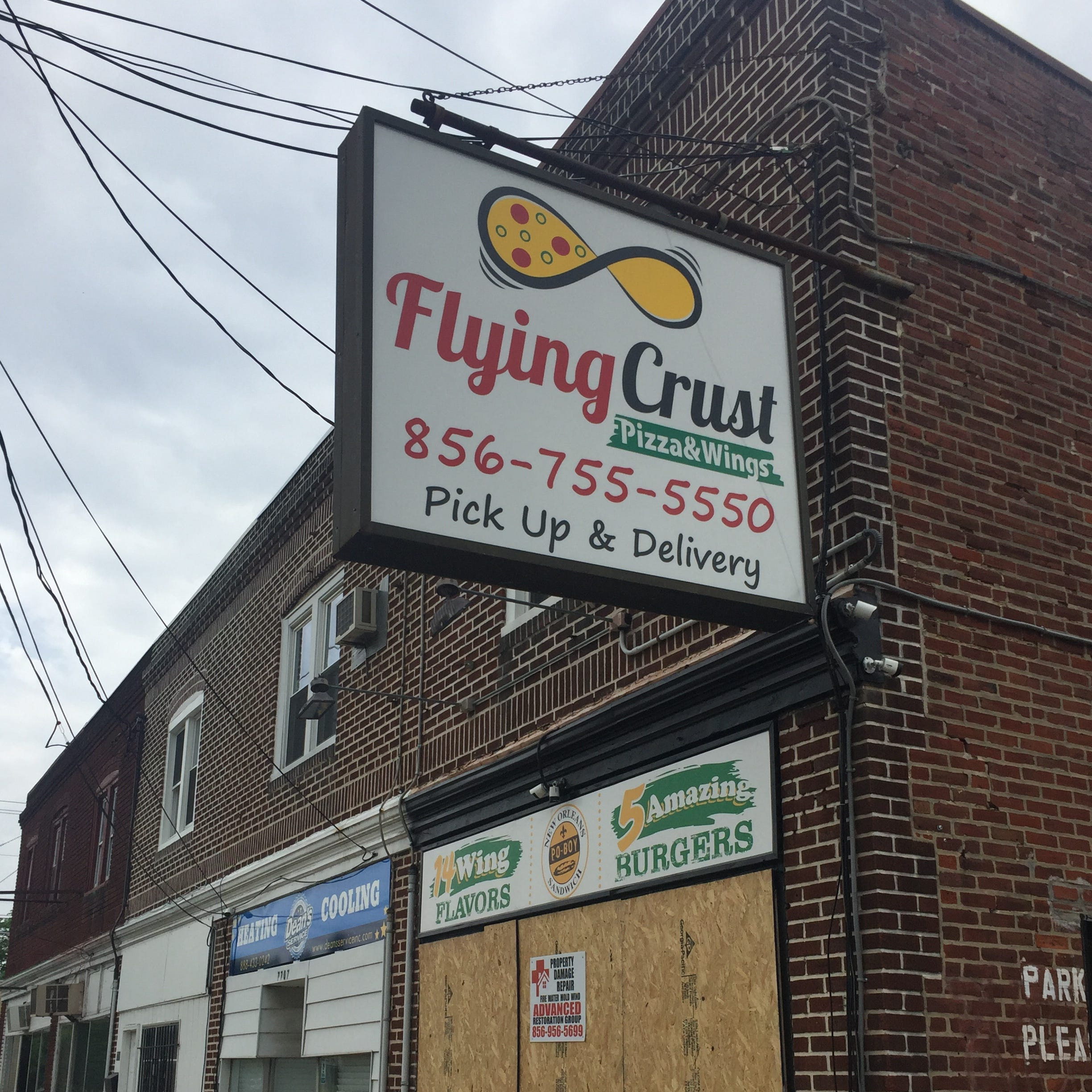 Teacher charged with DUI in car crash into  Pennsauken pizza and wings shop