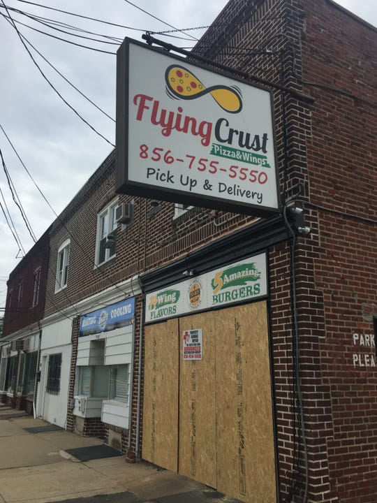 Flying Crust pizza and wings shop on Park Avenue in Pennsauken remains closed and boarded up after a car drove into the business on May 3, 2019.