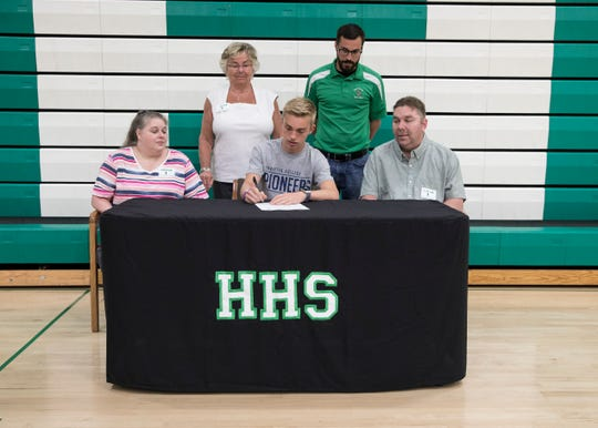 Huntington senior Hunter Sheets signed his letter of intent to run for Marietta College, in Marietta, Ohio, on Friday, May 4, 2019.