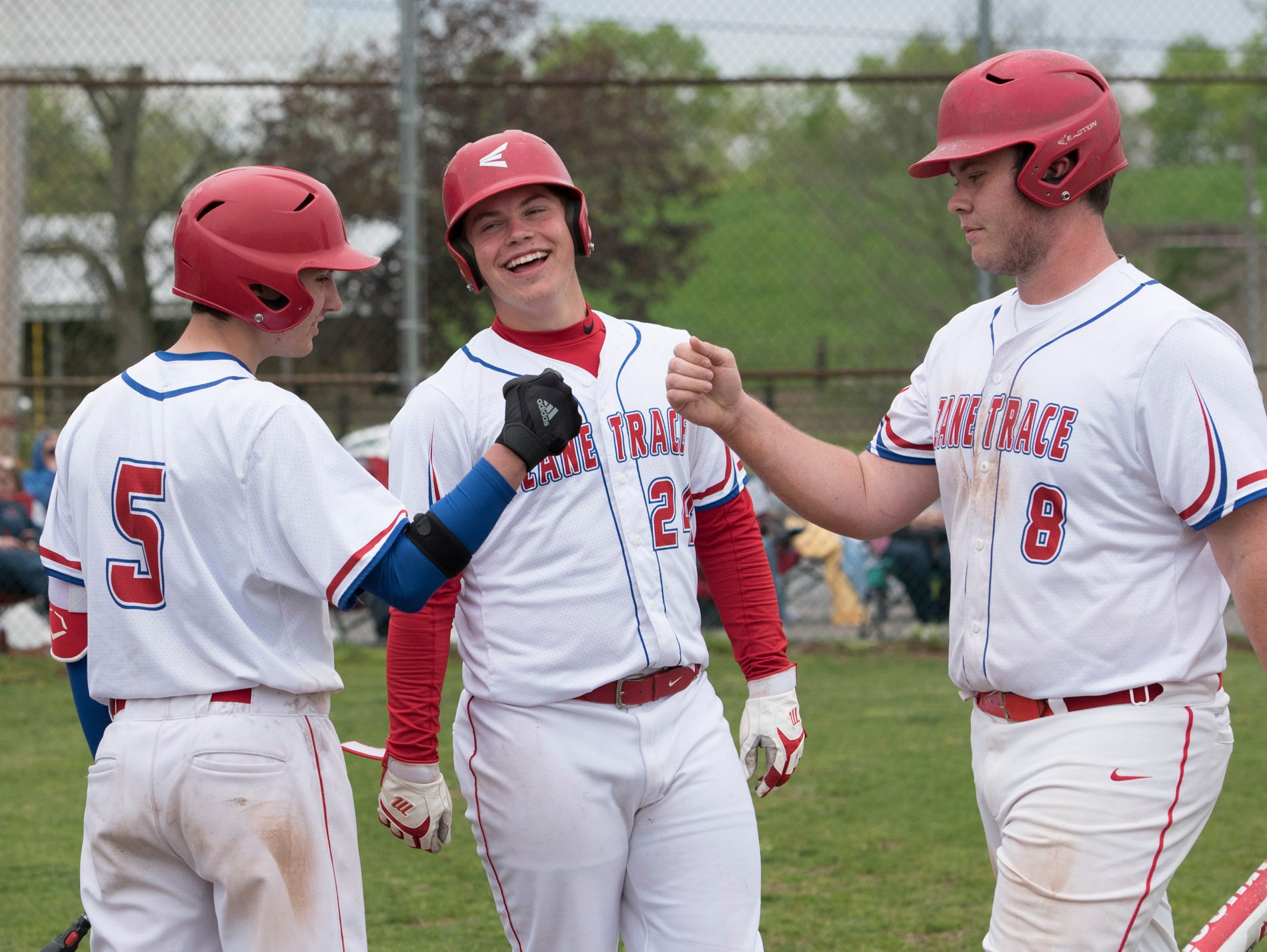 Chad Ison celebrates with fellow teammates after scoring against Chesapeake during a double header game earlier in the season.