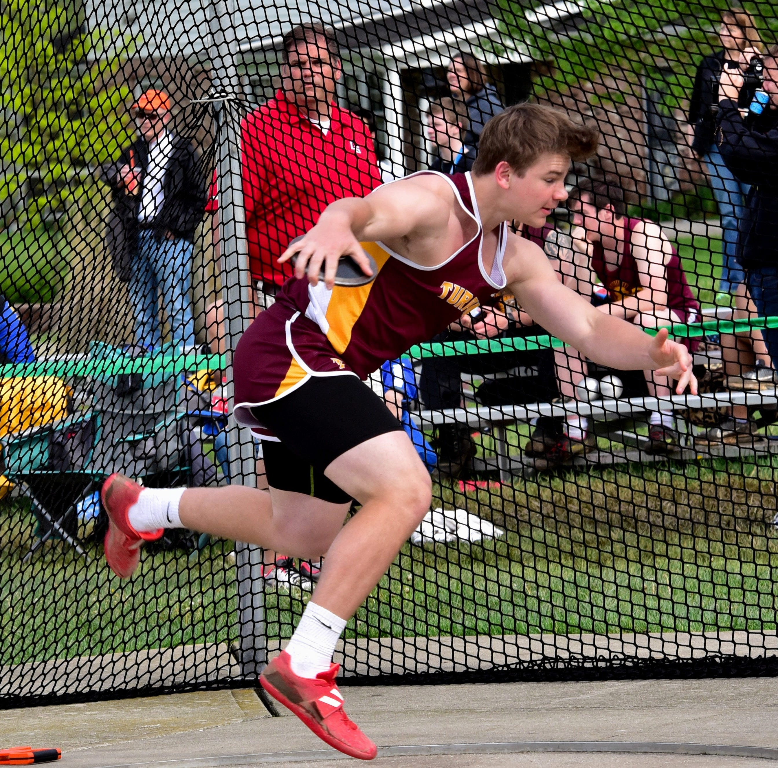 Turpin's Chris Ward takes to the air as his comes around for his discus throw at the Rod Russell/Mason Track & Field Invitational, May 3, 2019.