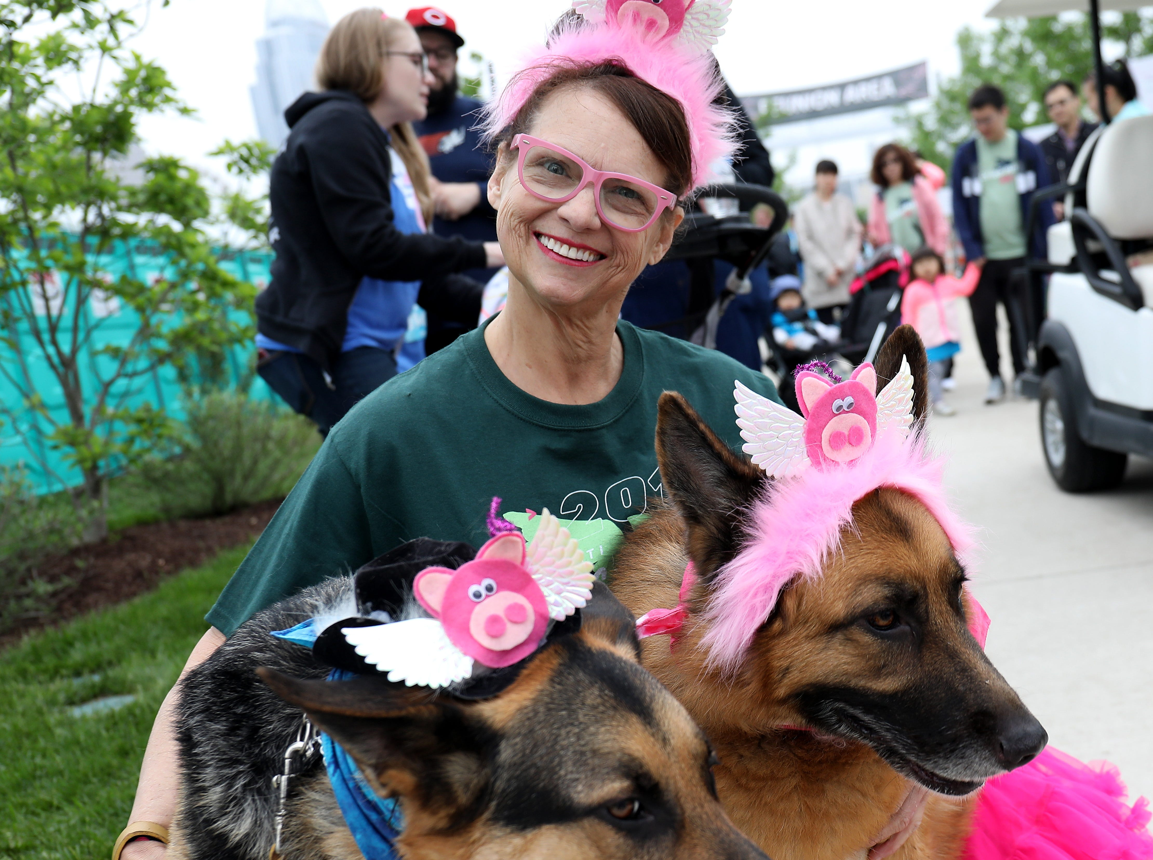 Karen Sicemalle with her dogs Daisey and Astro before  the Flying Fur race, Downtown Cincinnati Saturday , May 4,2019.