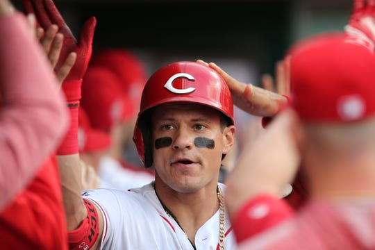 Cincinnati Reds left fielder Derek Dietrich is congratulated in the dugout after hitting a three-run home run in the first inning during an MLB baseball game against the San Francisco Giants on Friday, May 3, 2019, at Great American Ball Park in Cincinnati.