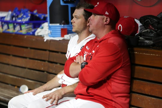 Cincinnati Reds starting pitcher Sonny Gray and Cincinnati Reds pitching coach Derek Johnson talk in the dugout between the fourth and fifth innings during an MLB baseball game against the San Francisco Giants on Friday, May 3, 2019, at Great American Ball Park in Cincinnati.