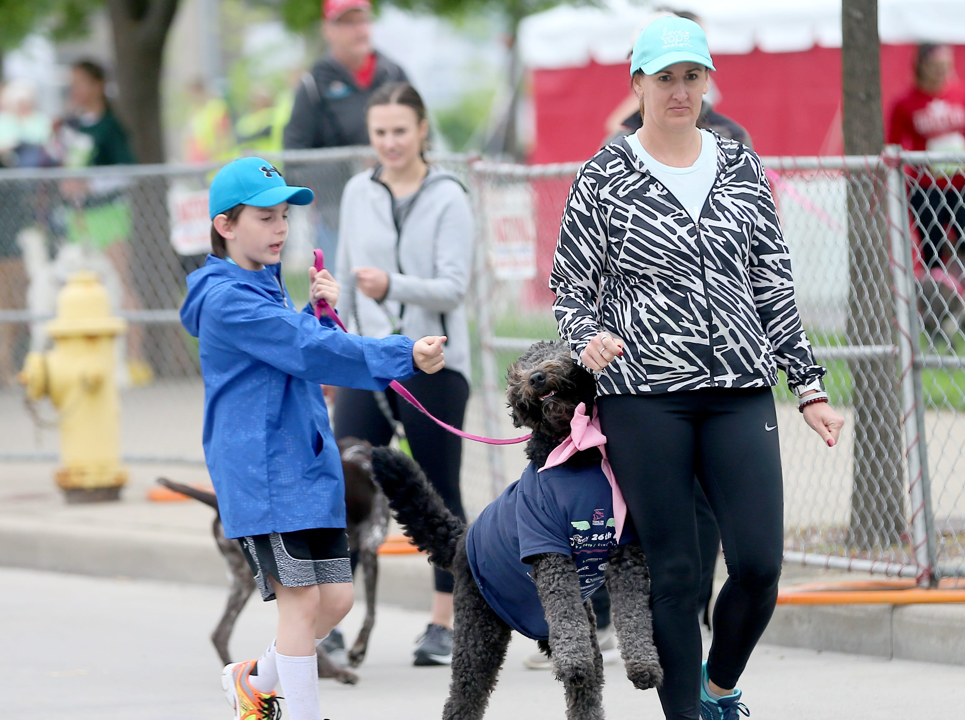 Nicole and Reese  Mardis  with their dog Marley before the Flying Fur race in Downtown Cincinnati, Saturday, May 4,2019.