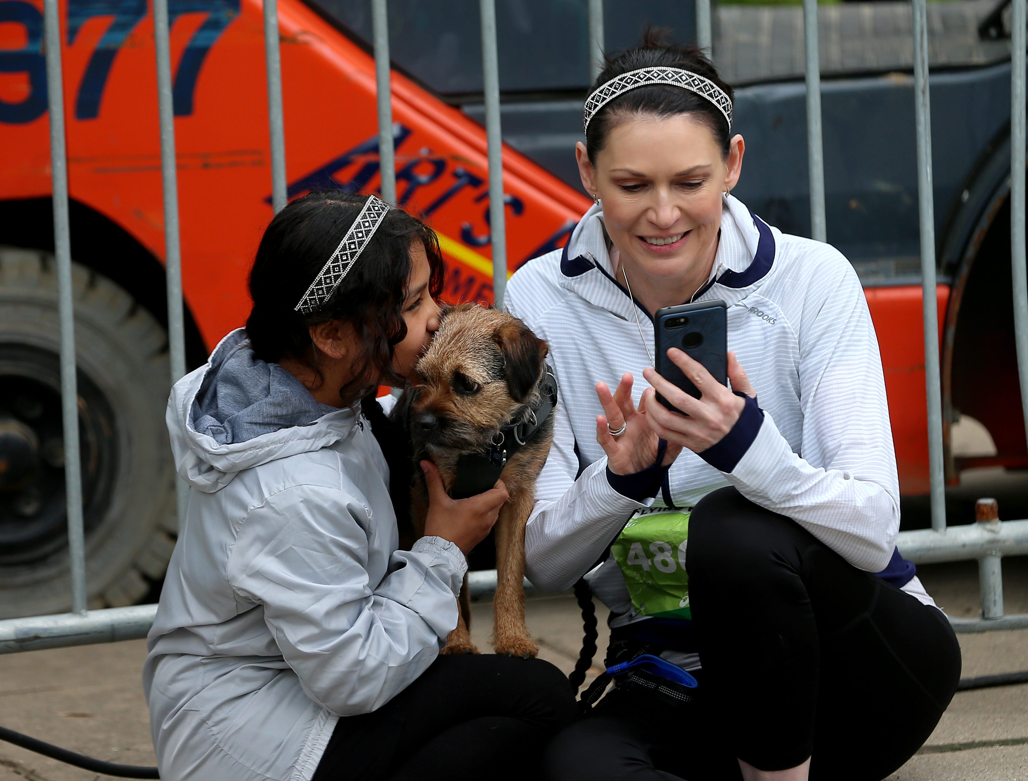 Catherine Lees and Madaline Lees with there dog  Indy before the Flying Fur race, Downtown Cincinnati, Saturday, May 4,2019