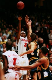 UC's DerMarr Johnson goes for the 3-pointer in 2000 game at the Shoemaker Center.