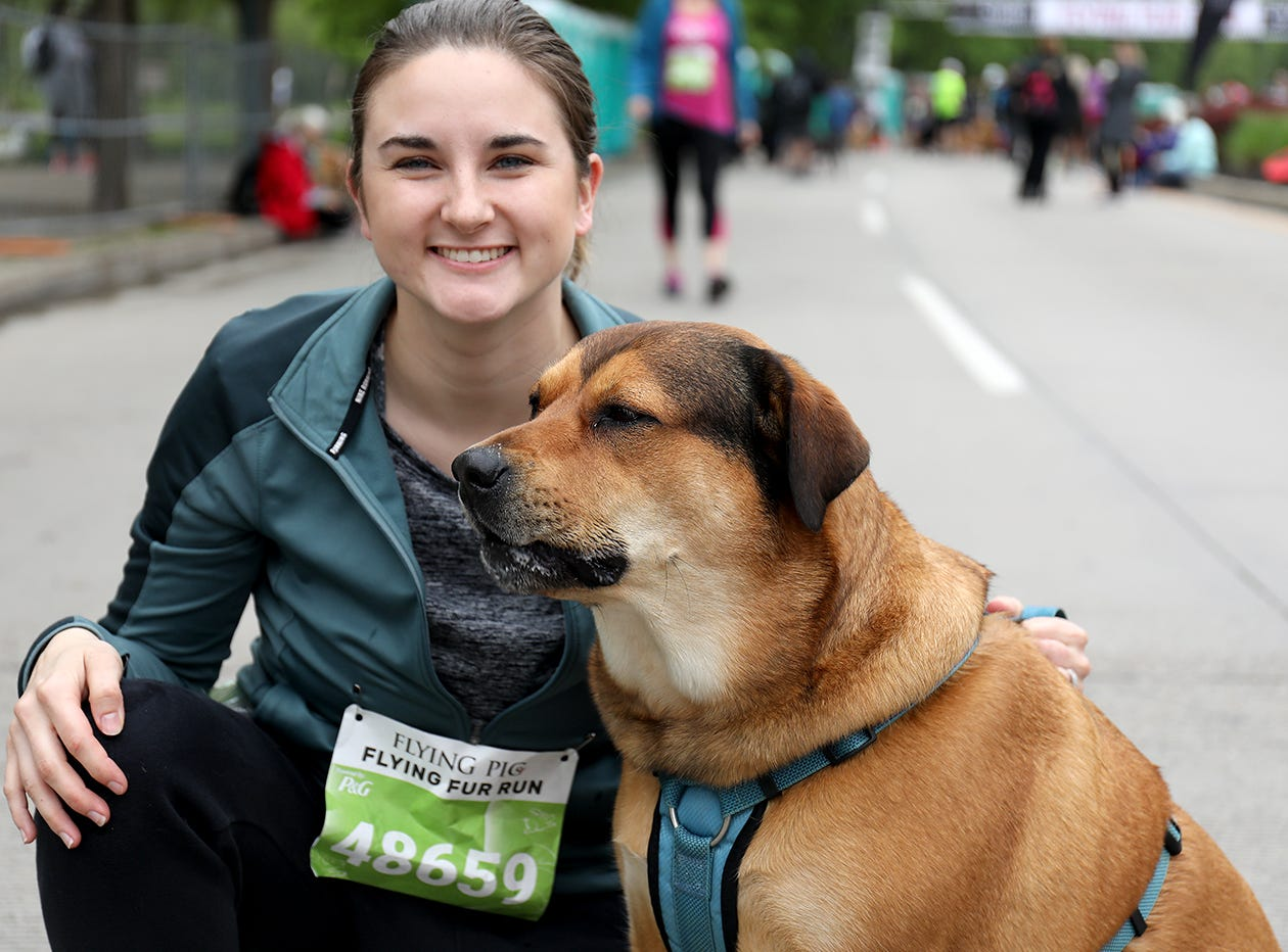 Stacy  Karlin with her dog Jas before  the Flying Fur race, Downtown Cincinnati, Saturday , May 4,2019.