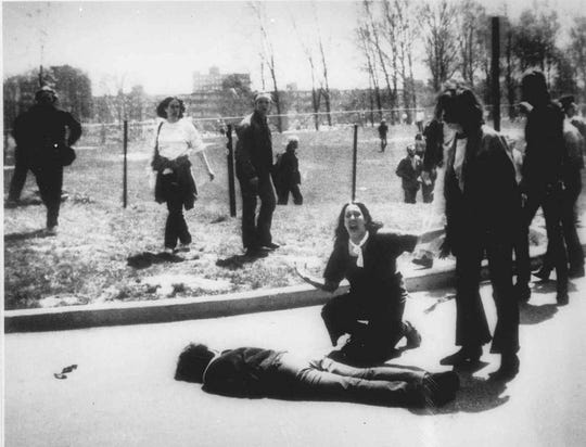 Mary Ann Vecchio gestures and screams as she kneels by the body of a student lying face down on the campus of Kent State University, Kent, Ohio, on May 4, 1970. Four students died and nine others were wounded during student protests against the Vietnam War when National Guardsman opened fire.