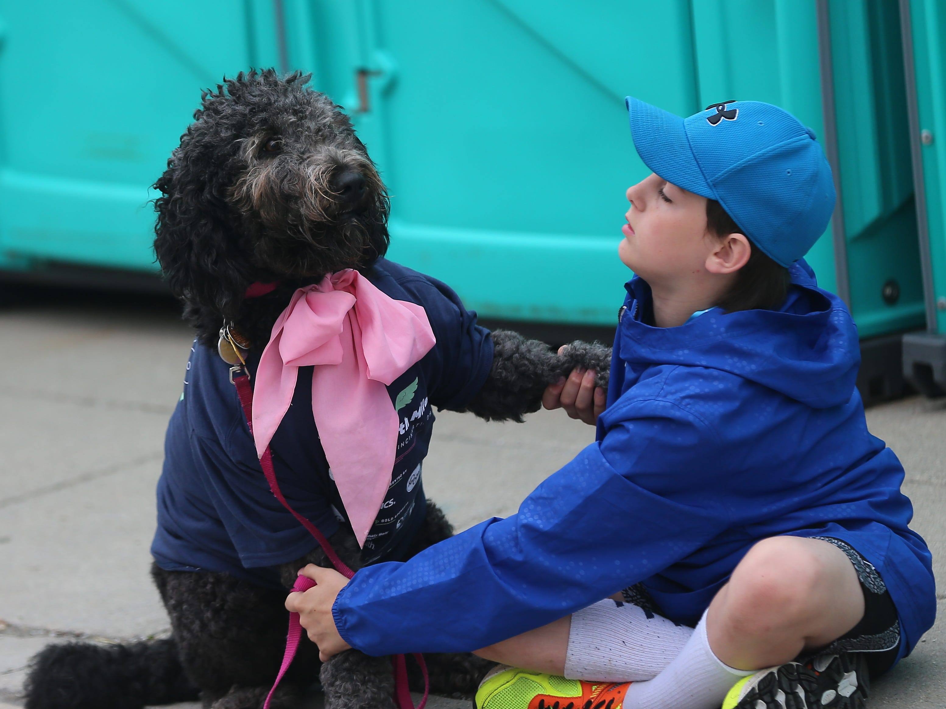 Reese Mardis with his dog Marley before the Flying Fur race, Downtown Cincinnati, Saturday, May 4,2019.