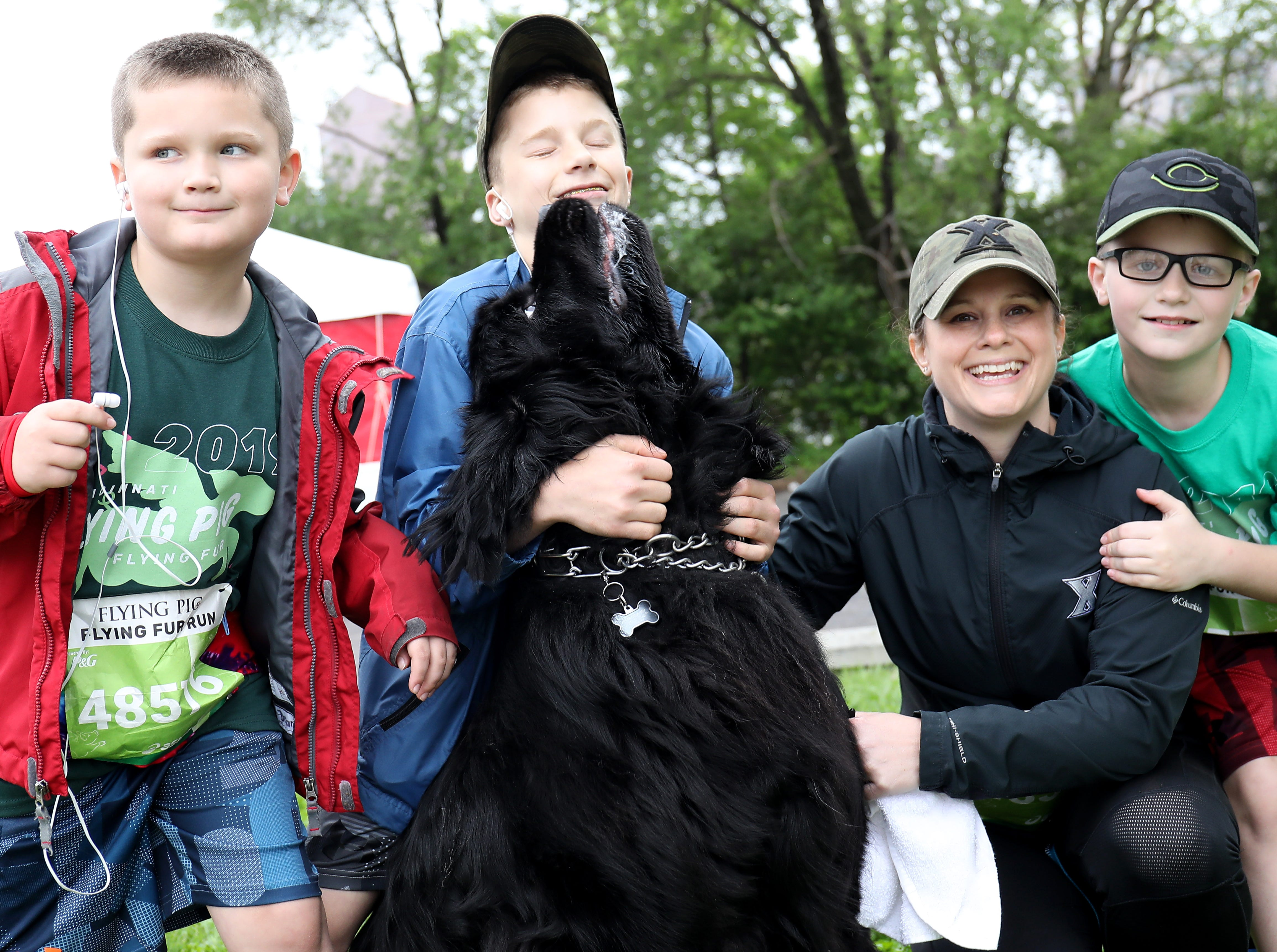 Bear (dog) with Jennifer  Delaney (mom)  Colin Brady, and Noah before  the Flying Fur race, Downtown Cincinnati Saturday, May 4,2019.